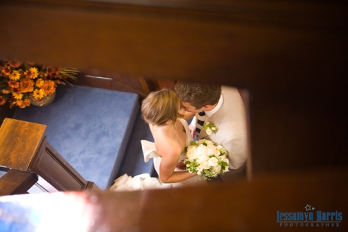Bride and Groom kiss at Sutter Club