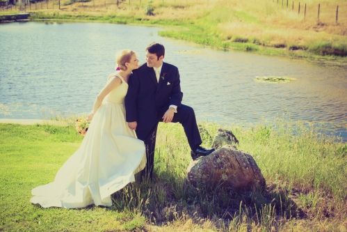 The bride and groom by the pond