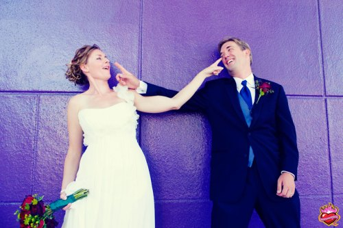 Bride and Groom in front of purple wall