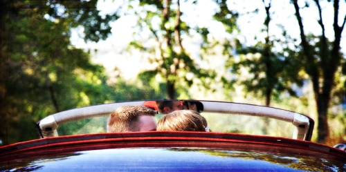 Bride and Groom in rearview mirror