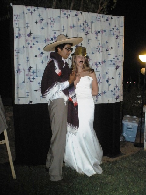 Bride and Groom having fun with a photobooth