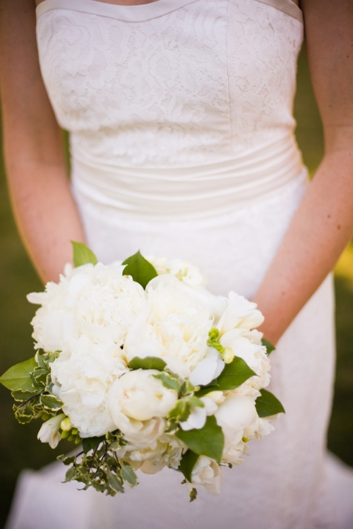 Bride's dress and white and green bouquet