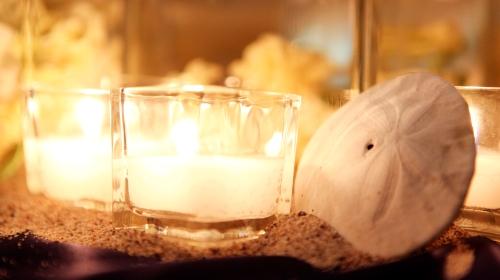 Candles, sand, and seashells