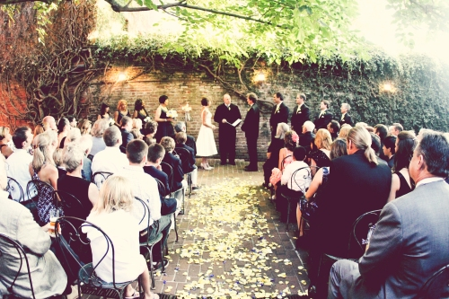 Ceremony with rose petals in aisle