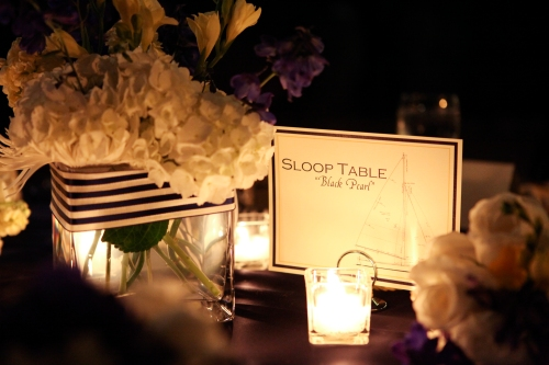 Nautical table, candles, blue and white flowers, table name
